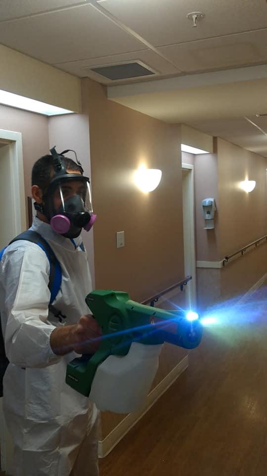 man disinfecting COVID-19