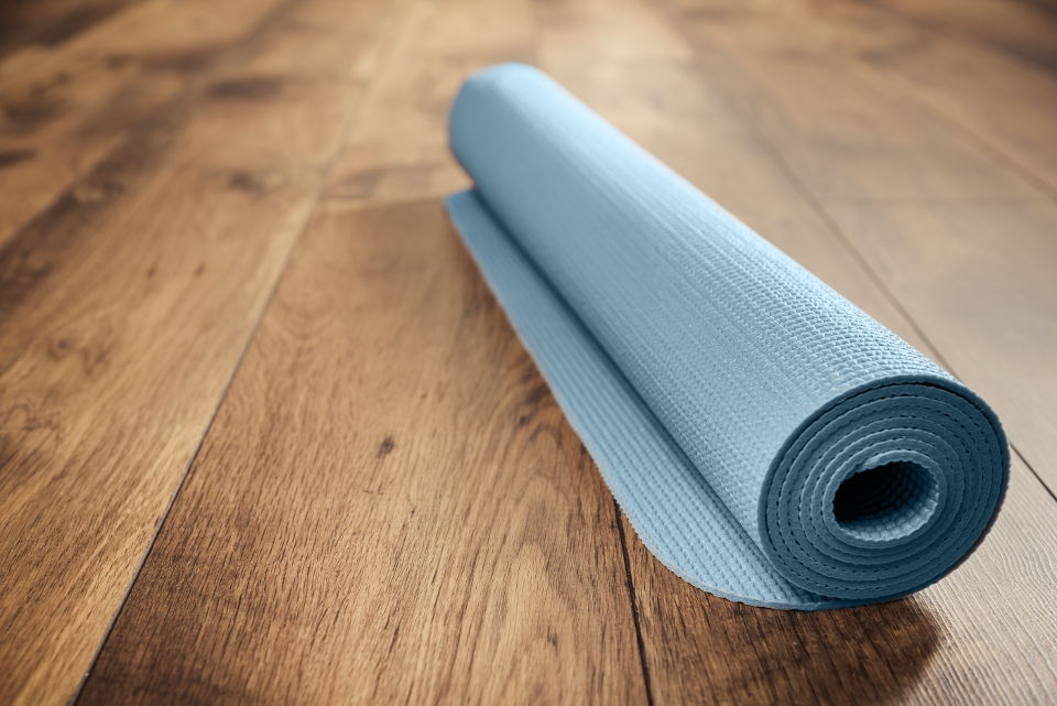 Yoga mat on hardwood flooring
