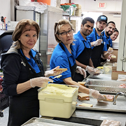 PPC team preparing sandwiches for the homeless